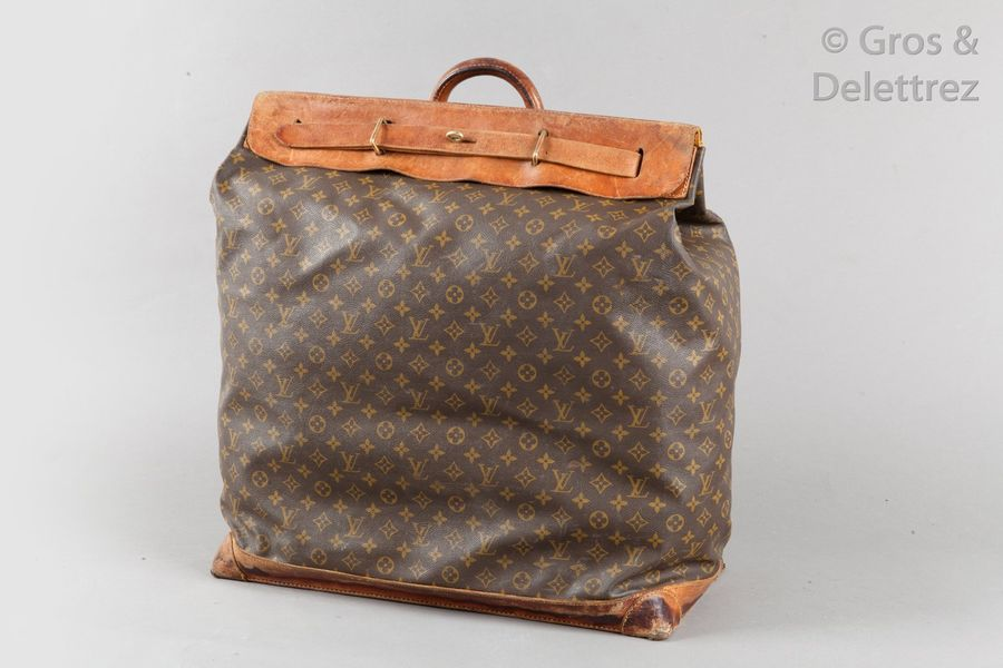 Louis VUITTON n° illisible Steamer bag 65cm en toile Monogramme et cuir naturel.…