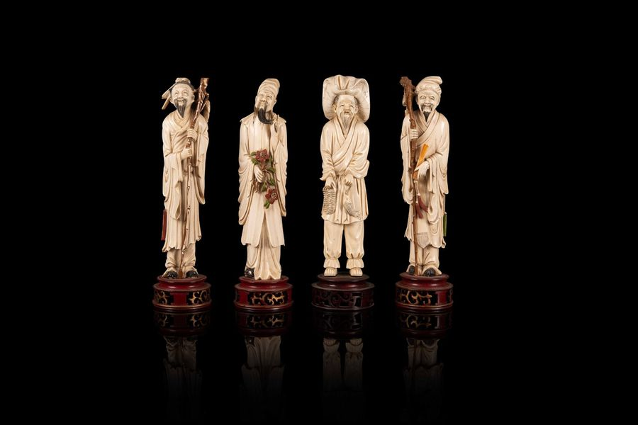 Réunion de quatre personnages  A set of four ivory figures, China and Japan, first…