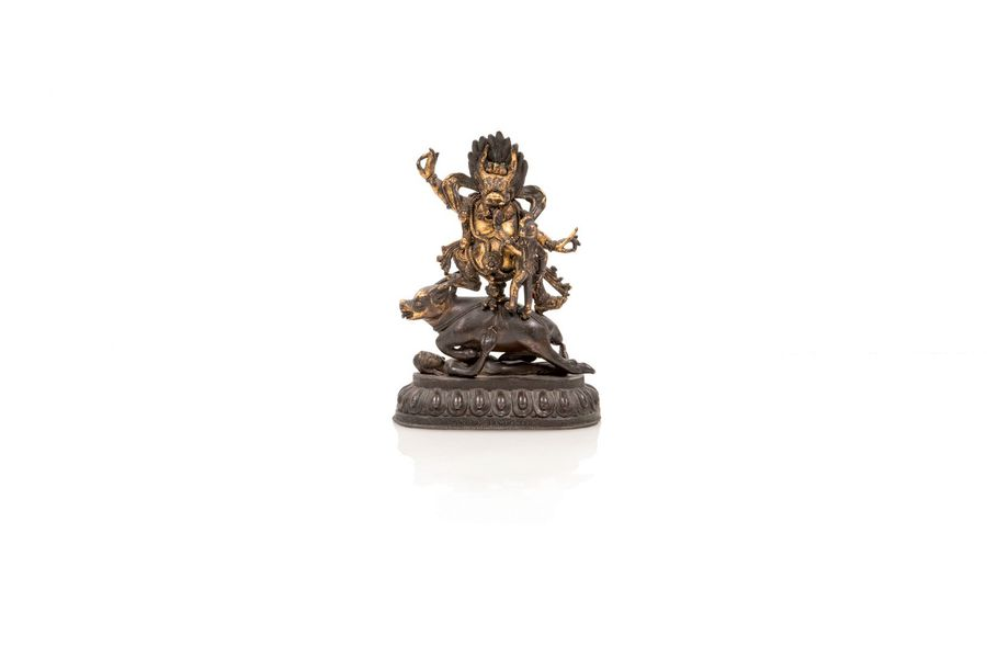 Yama Dharmaraja  A partially gilted bronze group of Yama Dharmaraja, Tibet, 19th…