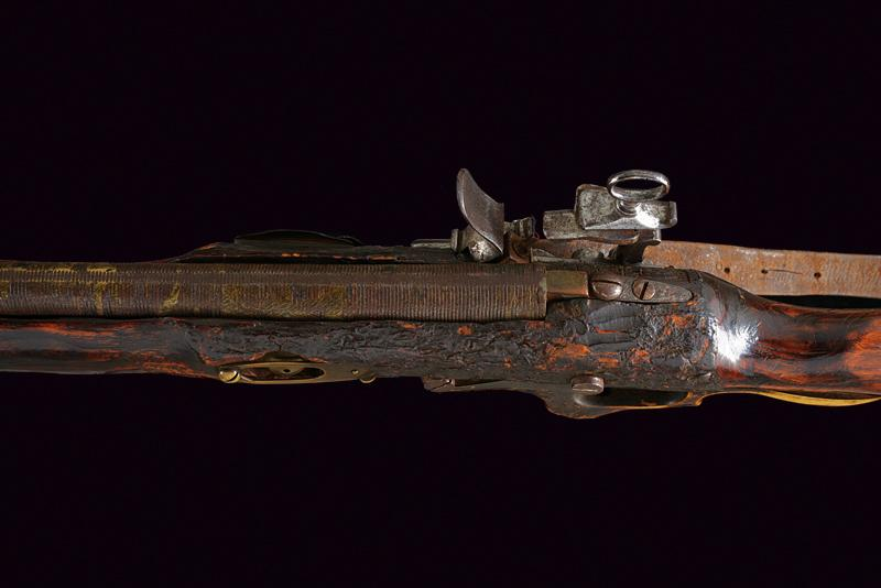 A composite curious percussion gun with fine Roman type lock dating: Mid 19th Ce…