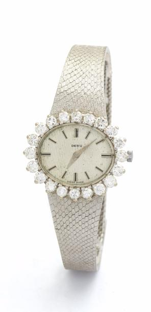 DERU MONTRE DE DAME en or gris, lunette diamants. Index argentés appliqués, Mouvement…