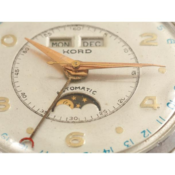 KORD WATCH & CO. Kord watch & Co, rare montre triple calendrier, phases lunaires,…
