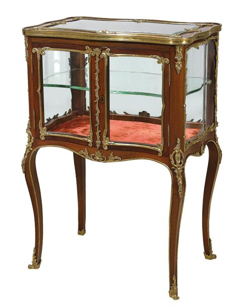 A Small Glass Display Cabinet, modified Louis XV style of the late 19th century …