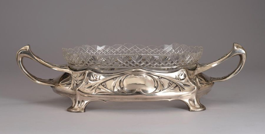 A large jardinière with two handles and bevelled glass liner, Gebrüder Kühn, Sch…