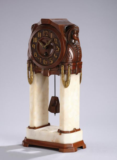 A mantel clock in historical style with Egyptian motifs, c. 1900 two architectur…