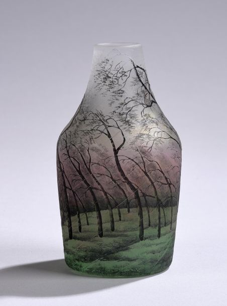 A vase with wooded landscape, Daum, Nancy, c. 1910 round body with tapering neck…