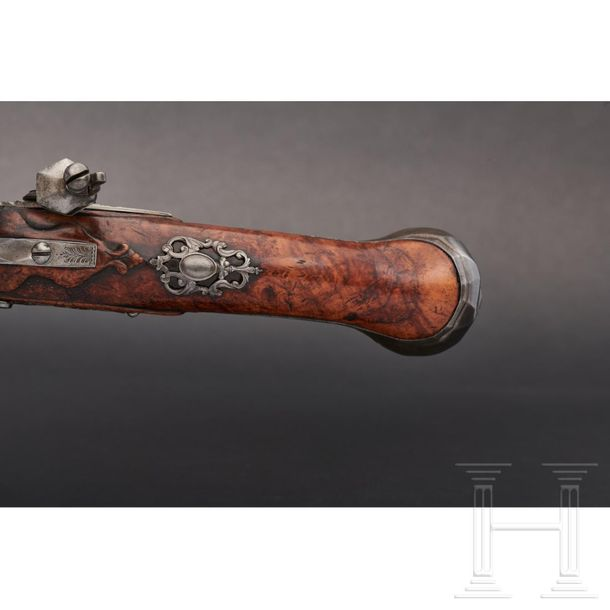 A pair of long flintlock pistols, E. Couna in Liège, circa 1710/20 Round barrels…