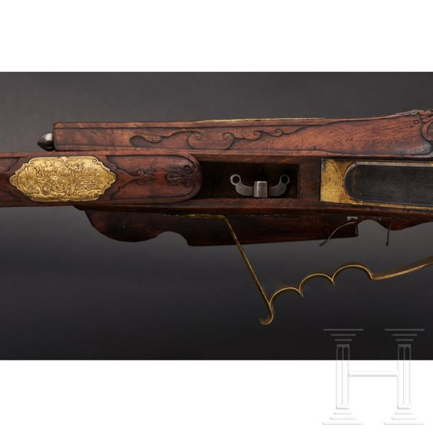 A deluxe wheellock rifle, Matthias Kubik of Prague, dated 1727 The octagonal bar…