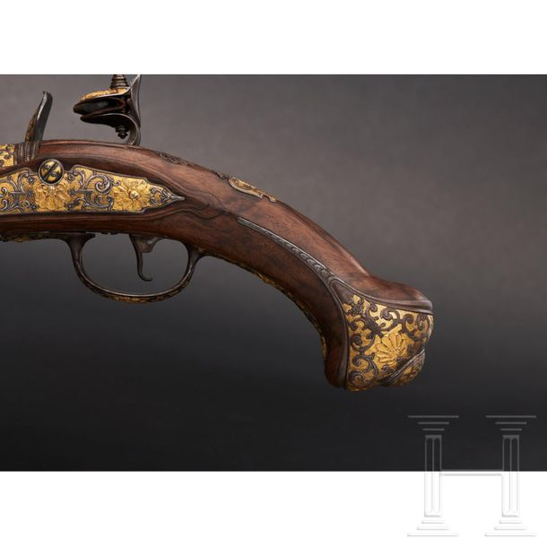 A fine Russian flintlock pistol with chiselled decoration, Tula, circa 1750 The …