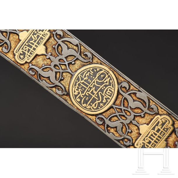 An Ottoman sword with a chiselled and gold inlaid blade, 18th century The elegan…