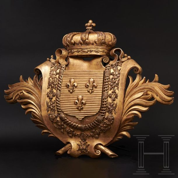 A gilt, wooden coat of arms for the kings of France, 18th century The escutcheon…