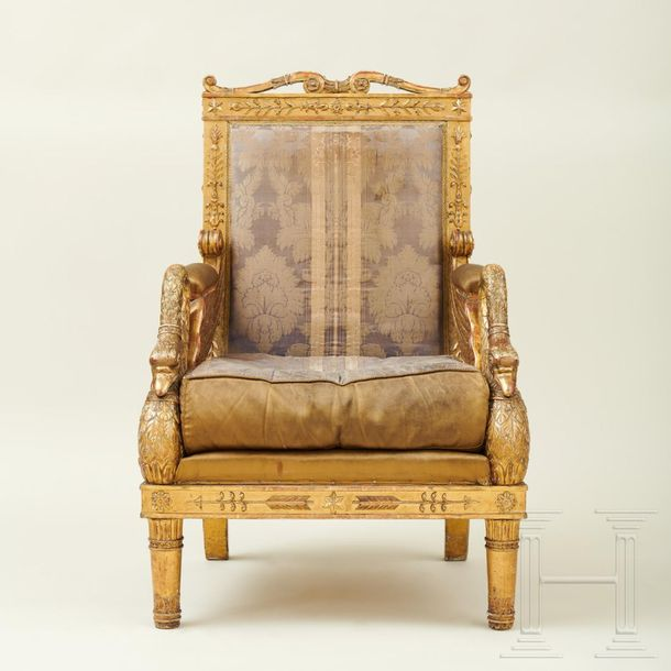 A splendid French armchair, Jacob model, early 19th century  The gold patinated …