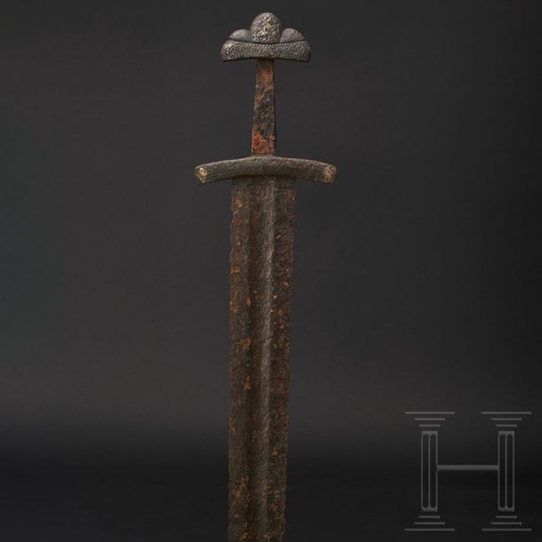 A North European Viking sword with silver inlaid hilt, 10th century The broad, d…