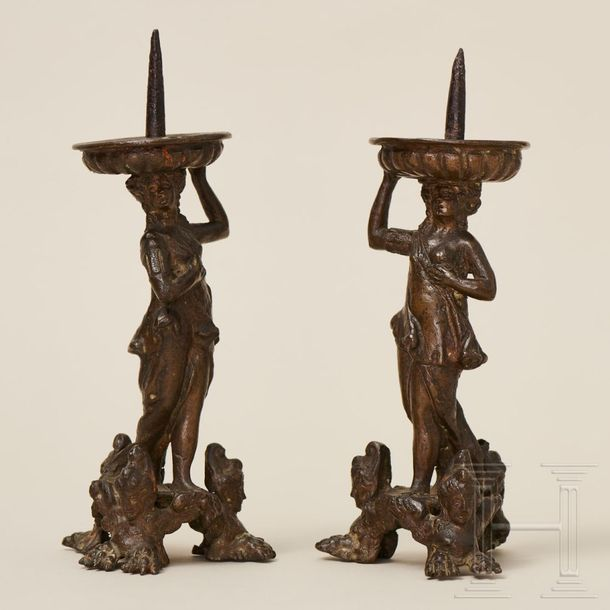A pair of Italian figurative candle holders in bronze, 16th century The bronze c…