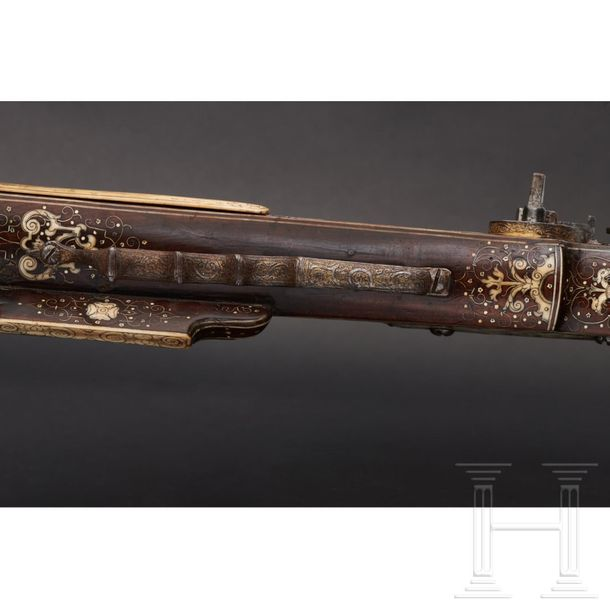 A significant South German wheellock rifle, veneered in bone, with etched lock a…