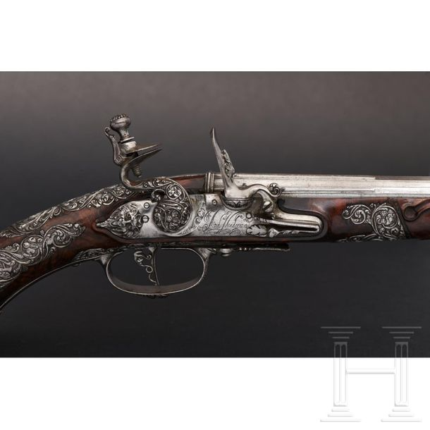 A pair of Brescian flintlock pistols with chiselled mounts by Andrea Medecina, c…