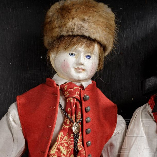 A showcase with a pair of dolls in Swabian costume, circa 1830 Dolls with wooden…