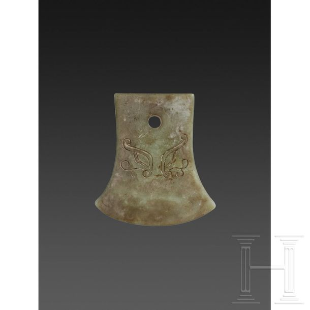 A Chinese jade pendant in the form of an axe blade (Chang), circa 1900 Pendant i…