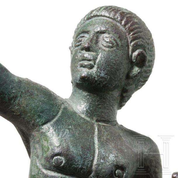 A graceful Roman bronze figure of a victorious athlete, 2nd century Naked youth,…