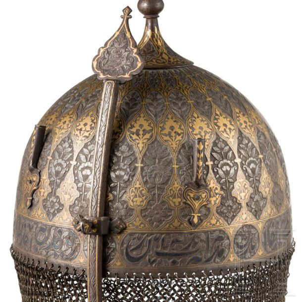 A chiselled and gold damascened Persian helmet and shield, 19th century A matchi…