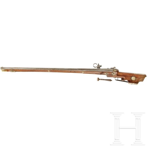 A South German bone inlaid wheel lock rifle, dated 1656 Slightly conically taper…