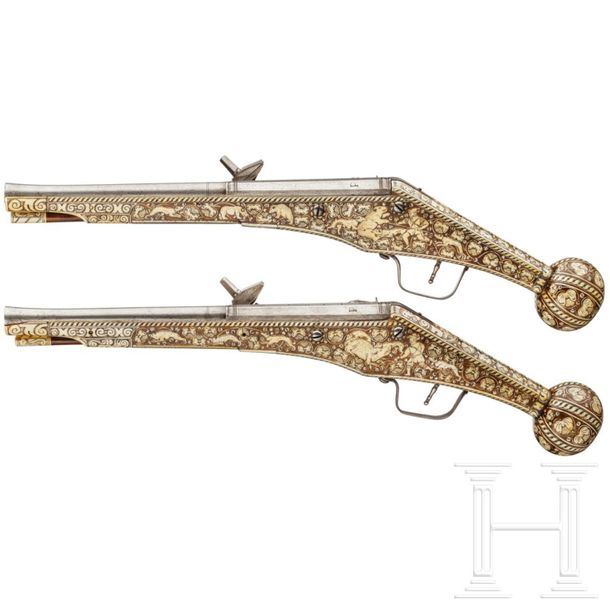 A pair of long wheellock pistols by Peter Danner, Nuremberg, dated 1587, with bo…