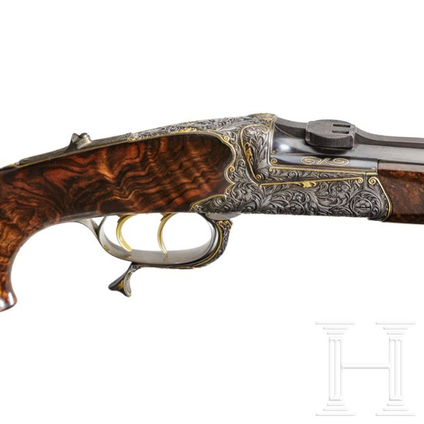 A cased deluxe break action rifle by Karl Hauptmann, Ferlach, with Zeiss scope C…