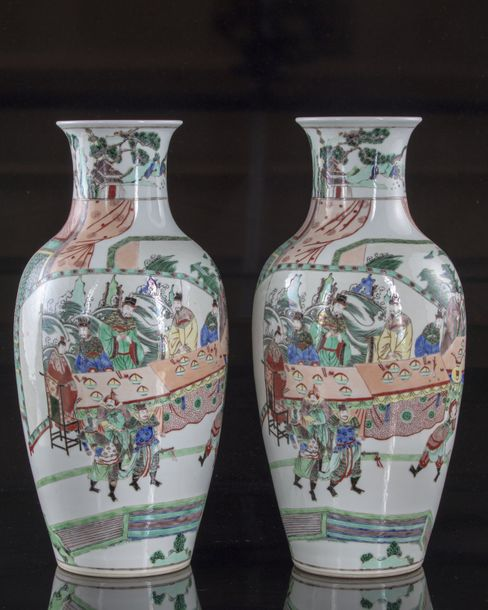 A Chinese pair of famille verte vases Both vases are decorated with dignitary fi…