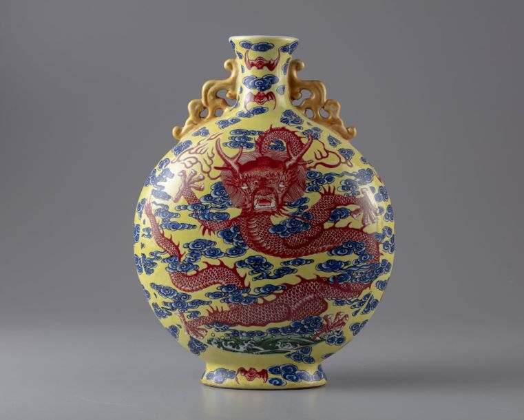 A Chinese yellow ground 'dragon' moonflask The vase is decorated to each side in…