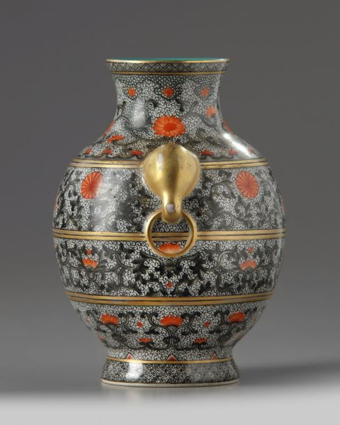 A small Chinese iron red and gilt decorated vase, hu The vase is decorated to th…