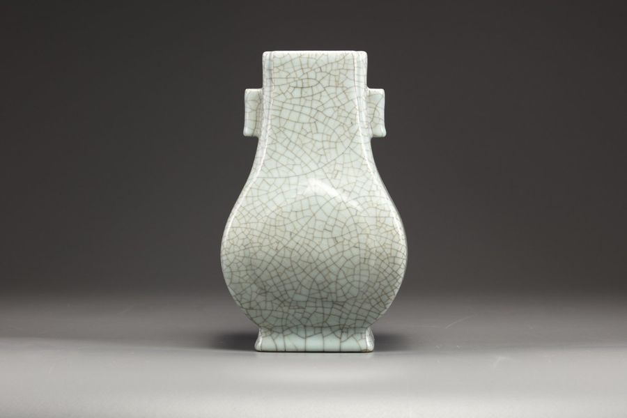 A Chinese crackle glazed twin handled hu vase The two broad sides moulded with a…