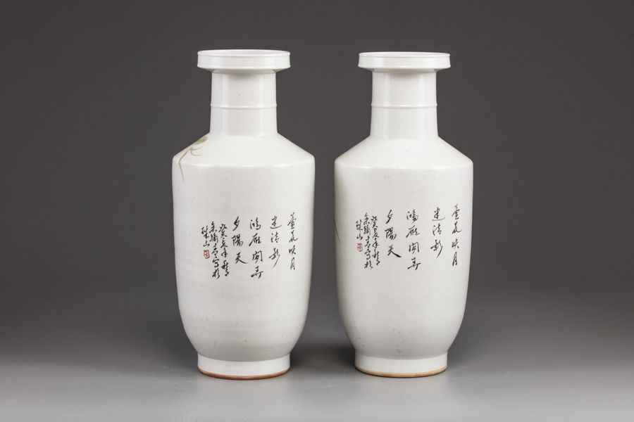 A pair of Chinese famille rose vases Each vase is decorated with cranes perched …