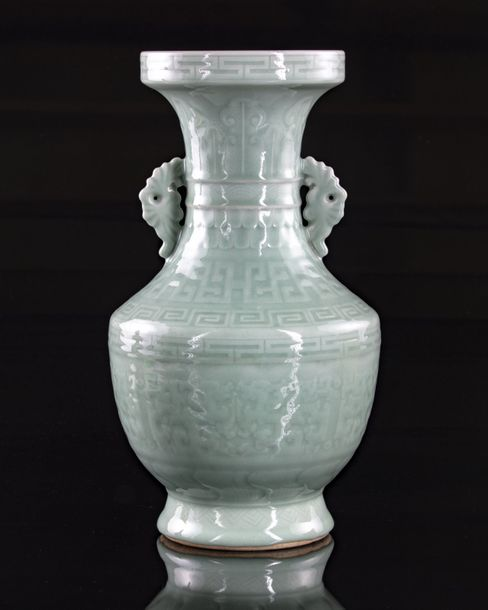 A Chinese celadon glazed 'kui dragon' vase The vase is decorated with two moulde…
