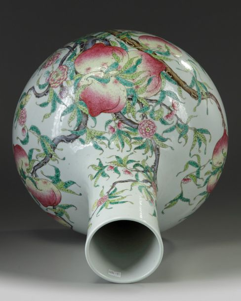 A large Chinese famille rose 'nine peaches' bottle vase, tianqiuping The vase is…