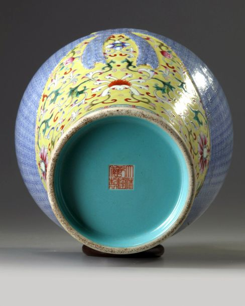 A Chinese yellow ground famille rose trompe l'oeil vase The vase is decorated wi…