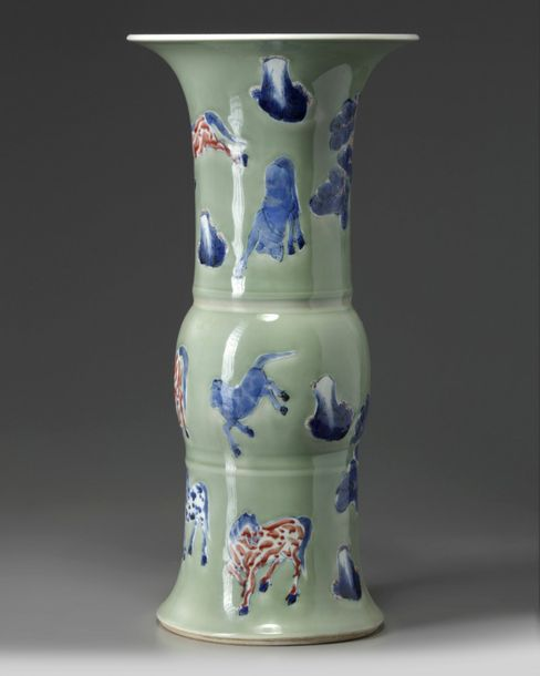 A Chinese celadon ground blue and white and copper red decorated gu vase The vas…
