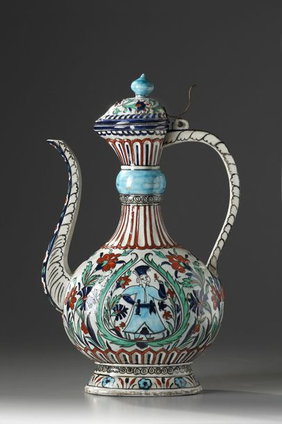 An Iznik style pottery ewer With rounded body rising from short flared foot, the…
