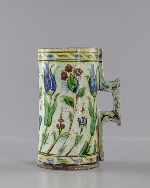 An Ottoman iznik pottery tankard Of cylindrical form with slightly flaring rim a…