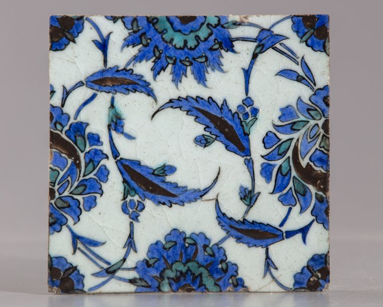 An Ottoman square Iznik tile An Ottoman square Iznik tile, decorated in blue, tu…