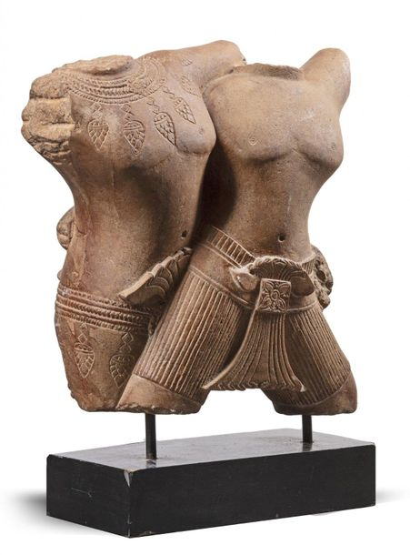 A CONJOINED PINK SANDSTONE CARVING OF A COUPLE, KHMER ANGKOR PERIOD, 10TH CENTUR…