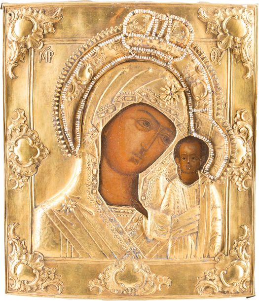 AN ICON SHOWING THE KAZANSKAYA MOTHER OF GOD WITH A SILVER GILT OKLAD Russian, 1…