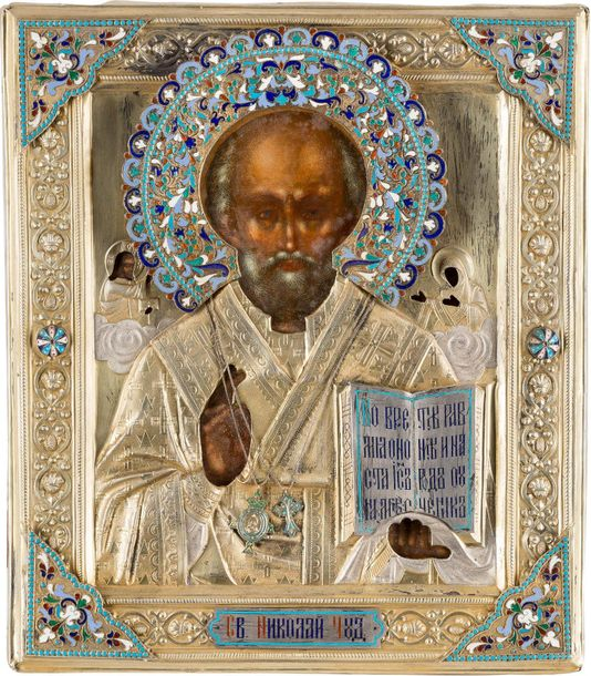 AN ICON SHOWING ST. NICHOLAS OF MYRA WITH A SILVER GILT AND CLOISONNÉ ENAMEL OKL…