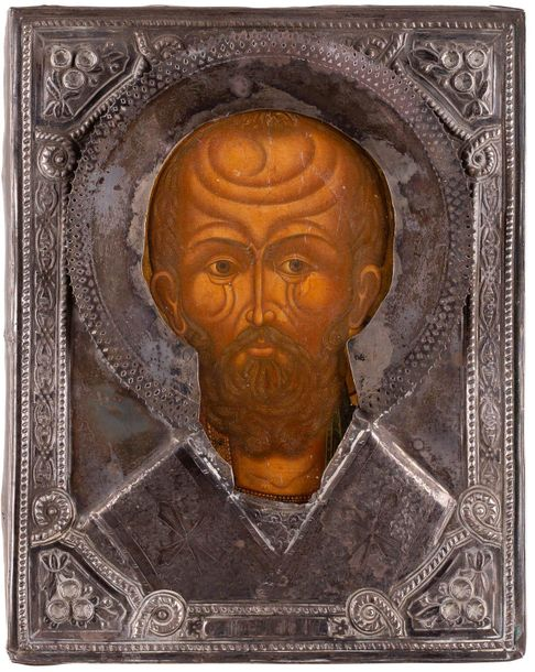 A SMALL ICON SHOWING ST. NICHOLAS OF MYRA WITH A SILVER OKLAD Russian, St. Peter…