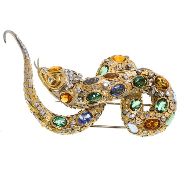 An 18KG Gemstone Brooch In the shape of a snake, 80 x 41 mm., set with many prec…