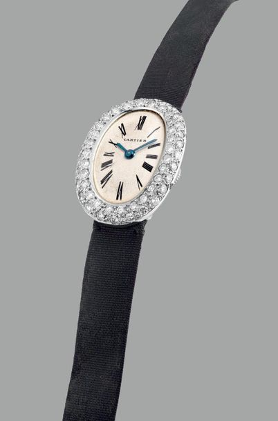 Cartier A lady's fine and elegant oval shaped platinum and diamond set wristwatc…