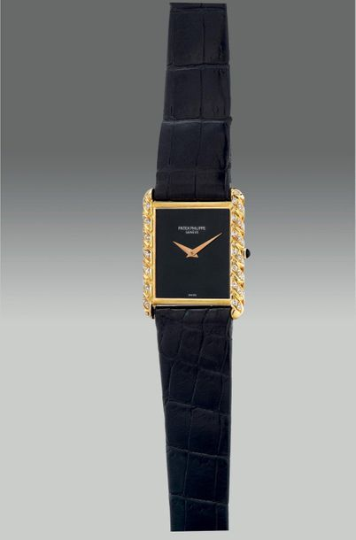 Patek Philippe A fine and elegant yellow gold and diamond set rectangular shaped…