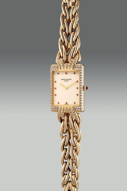 Patek Philippe A lady's fine and elegant rectangular shaped yellow gold and diam…