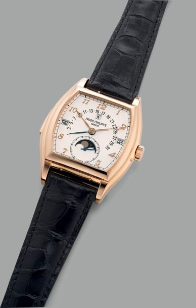 Patek Philippe An extremely fine and impressive pink gold tonneau shaped minute …
