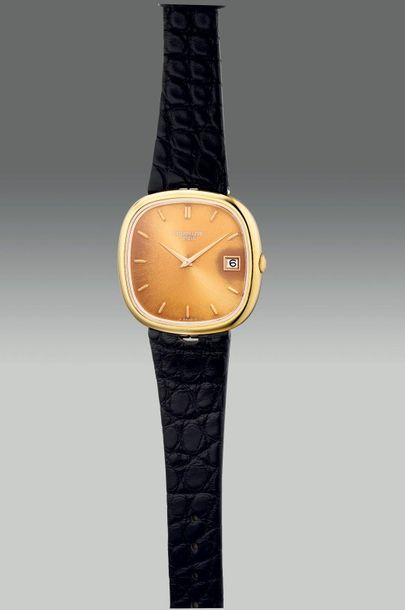 "Patek Philippe A fine yellow gold cushion shaped wristwatch with date and ""tropi…"