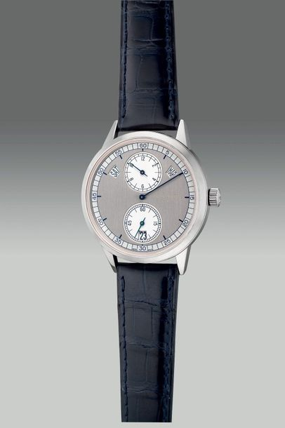 Patek Philippe A fine and rare white gold annual calendar wristwatch with two to…